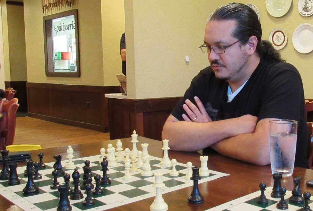 Louis Reed at the chess board