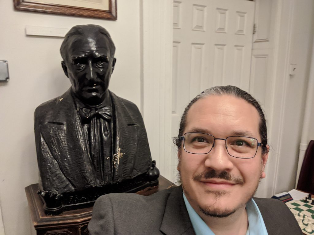 Bust of Frank James Marshall, two time United States Chess Champion (1909-1936) , and Texas Knights Editor, Louis Reed, at the Marshall Chess Club in Manhattan