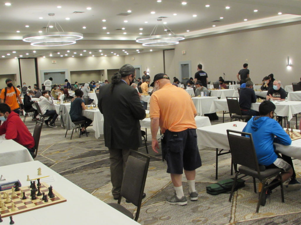 Arbiter and TD staff comparing notes. Photo by Arlington Chess Club's Jim Clarke.